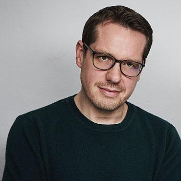Portrait Jan Grau vom HR-Startup ParrotPolls
